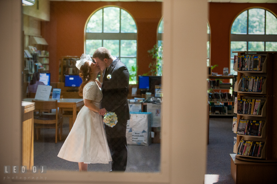 Bride and Groom kissing in the library. Fisherman's Inn, Safe Harbor Church, Kent Island, Eastern Shore Maryland, wedding reception and ceremony photo, by wedding photographers of Leo Dj Photography. http://leodjphoto.com