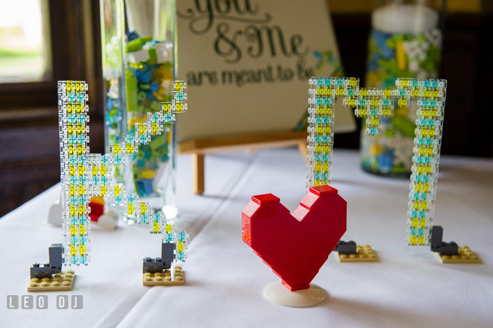 Table decor of initials of Bride and Groom's name and heart made out of LEGO. Fisherman's Inn, Safe Harbor Church, Kent Island, Eastern Shore Maryland, wedding reception and ceremony photo, by wedding photographers of Leo Dj Photography. http://leodjphoto.com