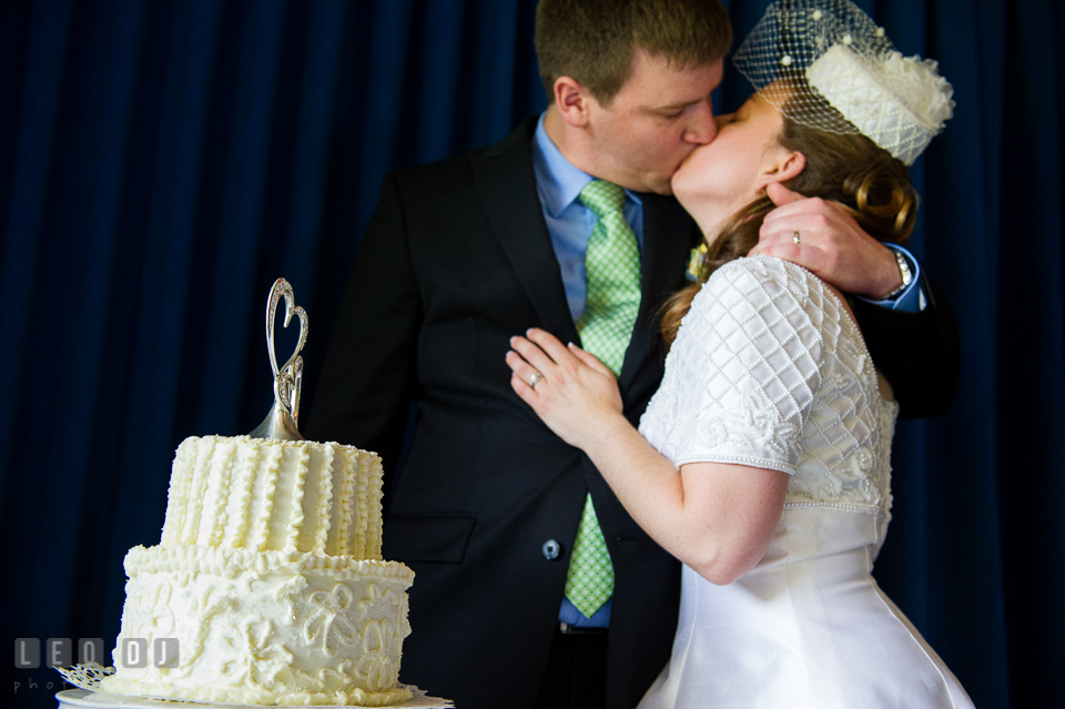 Bride and Groom kissing after the wedding cake cutting. Fisherman's Inn, Safe Harbor Church, Kent Island, Eastern Shore Maryland, wedding reception and ceremony photo, by wedding photographers of Leo Dj Photography. http://leodjphoto.com