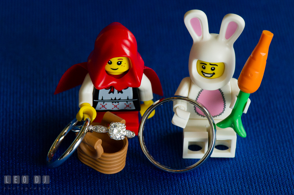Wedding bands and engagement ring displayed with LEGO mini figures. Fisherman's Inn, Safe Harbor Church, Kent Island, Eastern Shore Maryland, wedding reception and ceremony photo, by wedding photographers of Leo Dj Photography. http://leodjphoto.com