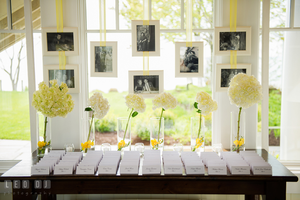 Seating place cards with photos of Bride and Groom parents' and grandparents' weddings. Kent Island Maryland Chesapeake Bay Beach Club wedding photo, by wedding photographers of Leo Dj Photography. http://leodjphoto.com