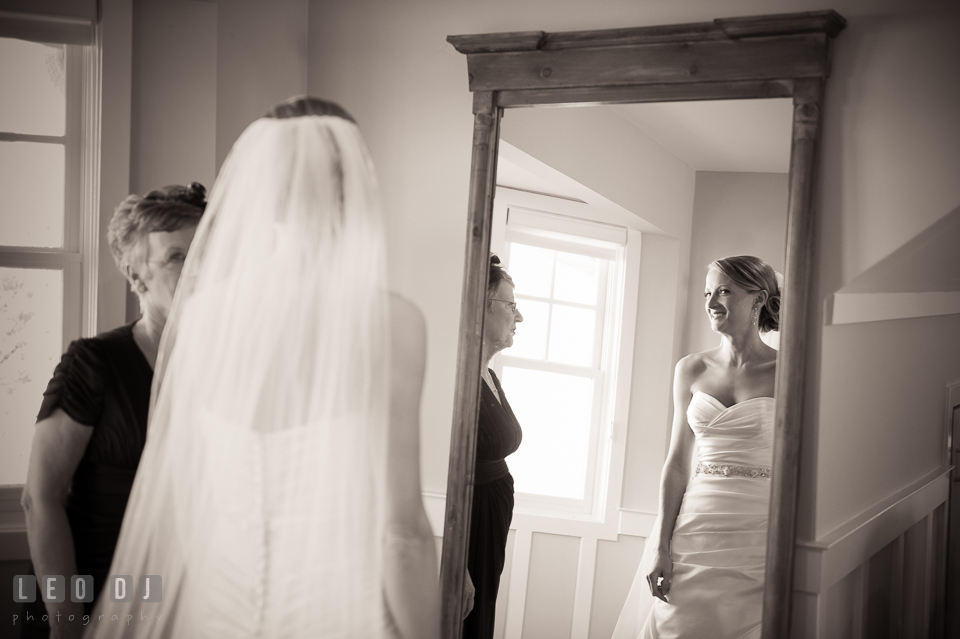 Bride checking her dress and veil on mirror with her Mother. Kent Island Maryland Chesapeake Bay Beach Club wedding photo, by wedding photographers of Leo Dj Photography. http://leodjphoto.com