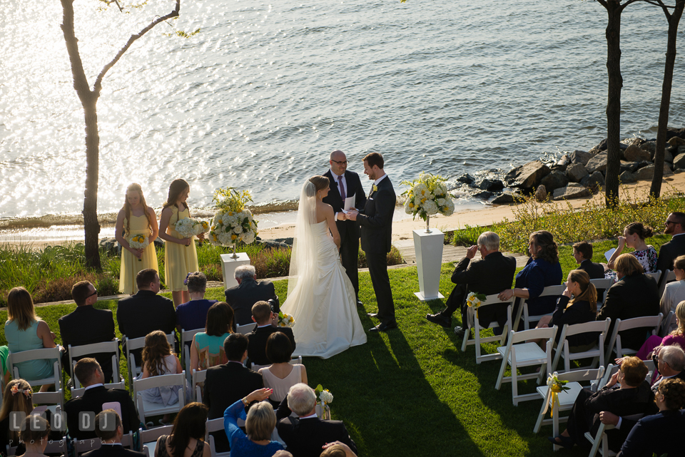 A bird's eye view of the Bride and Groom during the ceremony with water in the background. Kent Island Maryland Chesapeake Bay Beach Club wedding photo, by wedding photographers of Leo Dj Photography. http://leodjphoto.com