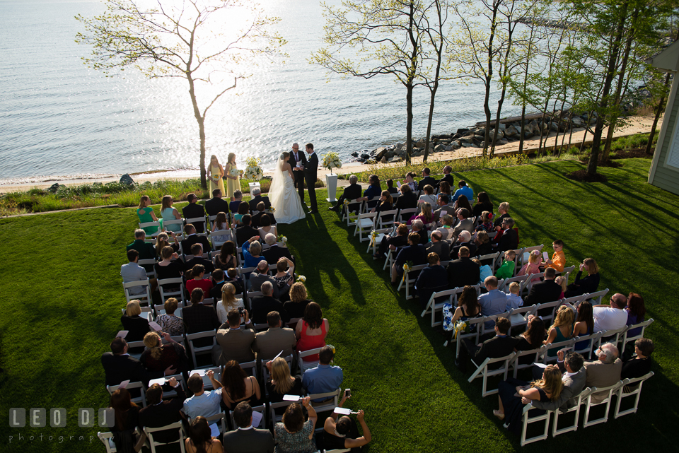 A view from above of the ceremony site with the beach and water in the background. Kent Island Maryland Chesapeake Bay Beach Club wedding photo, by wedding photographers of Leo Dj Photography. http://leodjphoto.com