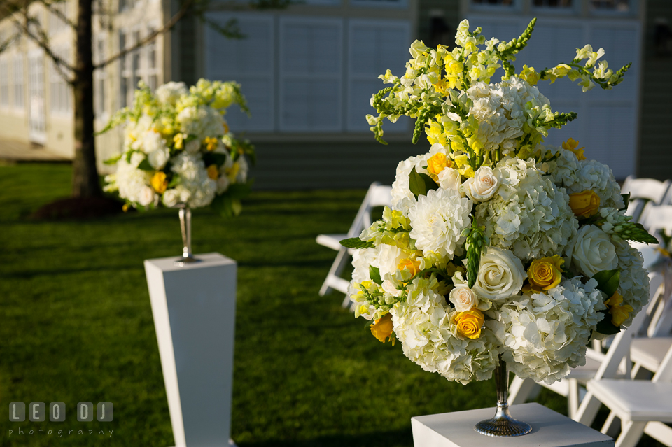White and yellow floral decorations with roses and hydrangeas by Contessa Flowers florist for the ceremony site. Kent Island Maryland Chesapeake Bay Beach Club wedding photo, by wedding photographers of Leo Dj Photography. http://leodjphoto.com