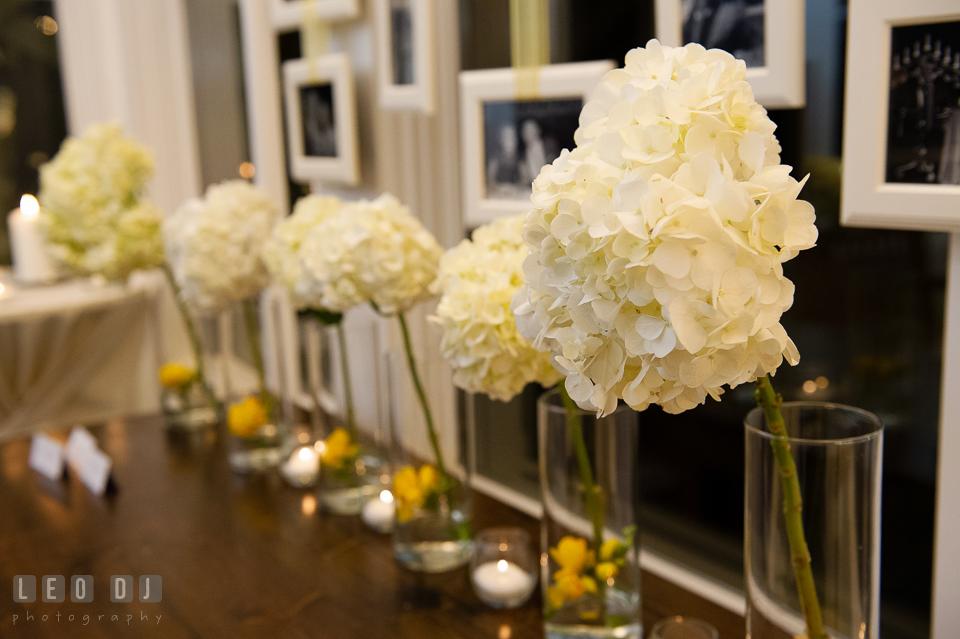 White hydrangeas floral decorations on the place card table by Contessa Flowers florist. Kent Island Maryland Chesapeake Bay Beach Club wedding photo, by wedding photographers of Leo Dj Photography. http://leodjphoto.com