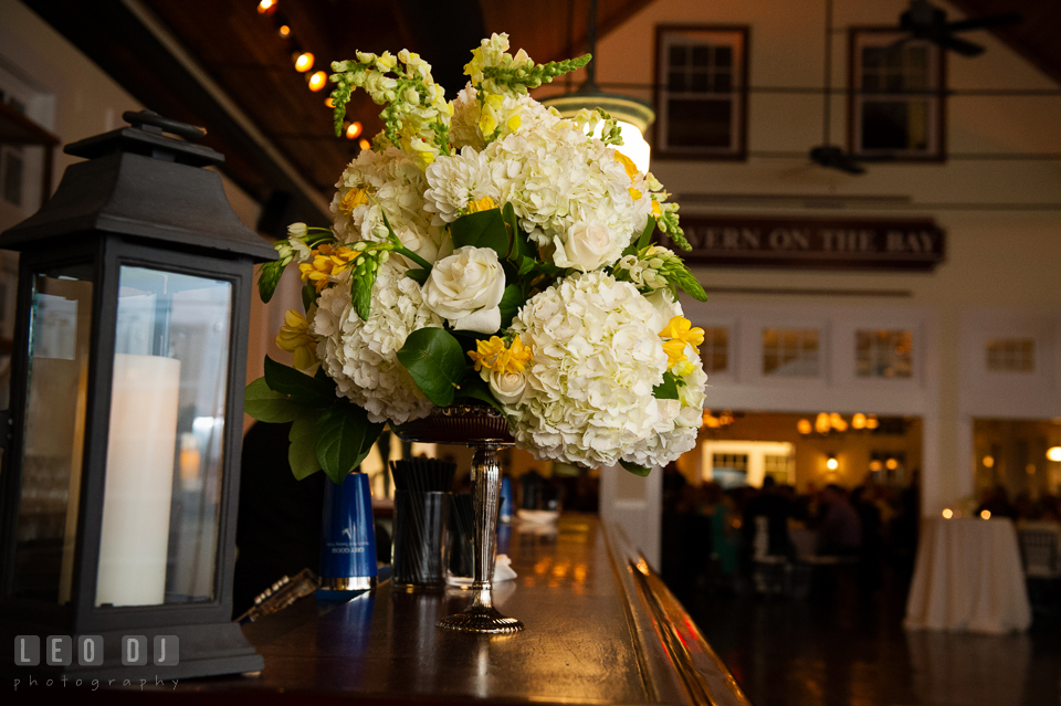 White and yellow floral decorations with roses and hydrangeas on the bar table by Contessa Florwers florist. Kent Island Maryland Chesapeake Bay Beach Club wedding photo, by wedding photographers of Leo Dj Photography. http://leodjphoto.com