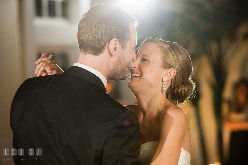 Bride and Groom laughing together during their first dance. Kent Island Maryland Chesapeake Bay Beach Club wedding photo, by wedding photographers of Leo Dj Photography. http://leodjphoto.com