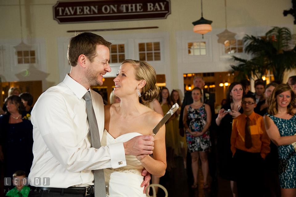 Bride and Groom laughing together during the cake cutting. Kent Island Maryland Chesapeake Bay Beach Club wedding photo, by wedding photographers of Leo Dj Photography. http://leodjphoto.com