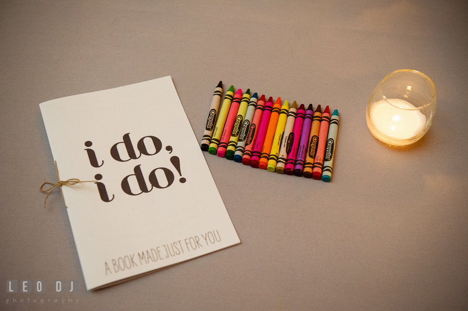 Books and colorful crayons for the guests to fill out. Kent Island Maryland Chesapeake Bay Beach Club wedding photo, by wedding photographers of Leo Dj Photography. http://leodjphoto.com