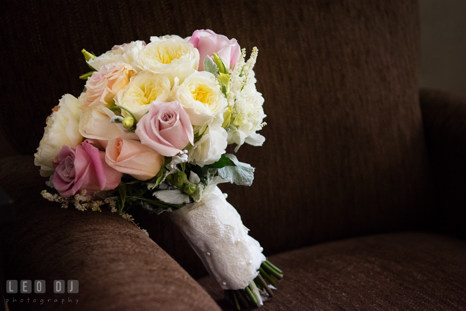 Wedding flower bouquet with white, pink, and pastel roses for the bride by Violets Florist. Historic Inns of Annapolis Maryland, Governor Calvert House wedding, by wedding photographers of Leo Dj Photography. http://leodjphoto.com