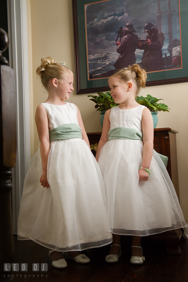 Two cute flower girls looking at each other. Historic Inns of Annapolis Maryland, Governor Calvert House wedding, by wedding photographers of Leo Dj Photography. http://leodjphoto.com