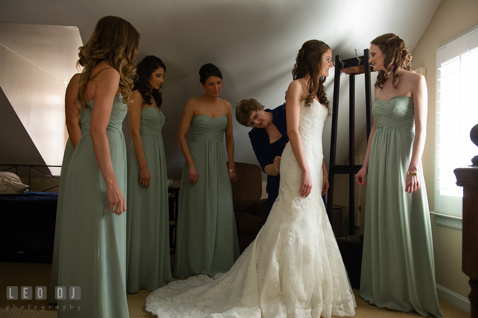Mother, Maid of Honor and Bridesmaids helping Bride put on and buttoning up her dress. Historic Inns of Annapolis Maryland, Governor Calvert House wedding, by wedding photographers of Leo Dj Photography. http://leodjphoto.com