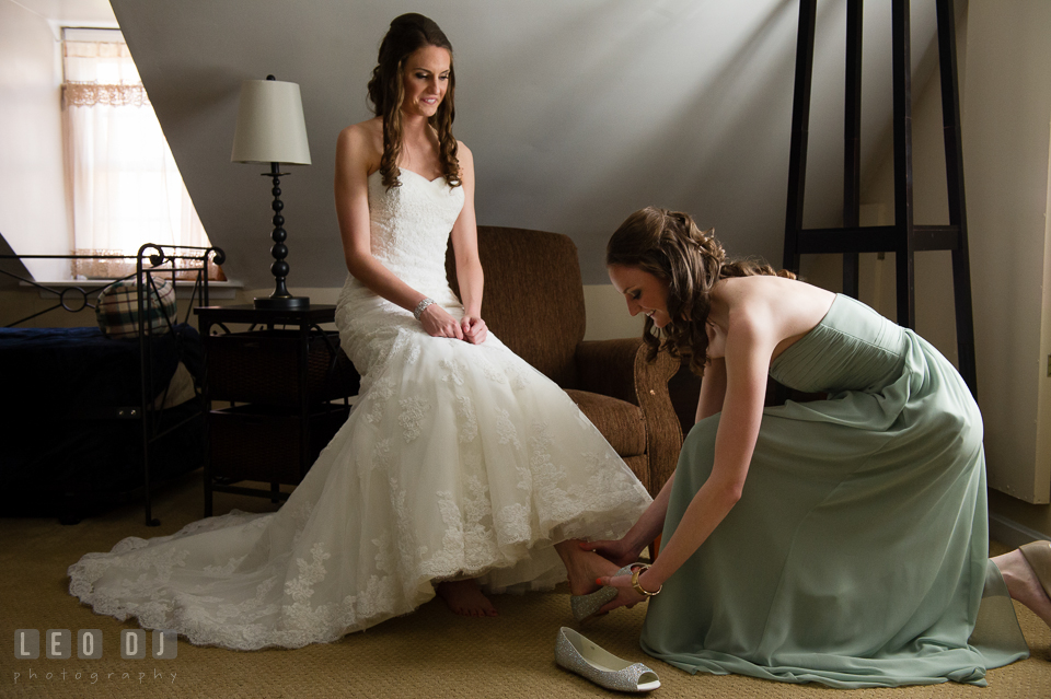 Maid of Honor and sister help Bride put on her shoes. Historic Inns of Annapolis Maryland, Governor Calvert House wedding, by wedding photographers of Leo Dj Photography. http://leodjphoto.com