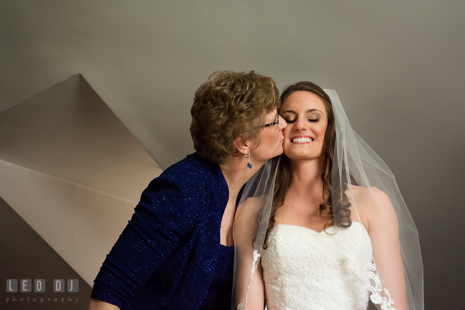 Mother of Bride kissing her daughter. Historic Inns of Annapolis Maryland, Governor Calvert House wedding, by wedding photographers of Leo Dj Photography. http://leodjphoto.com
