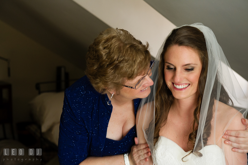 Mother of Bride smiling and hugging her daughter. Historic Inns of Annapolis Maryland, Governor Calvert House wedding, by wedding photographers of Leo Dj Photography. http://leodjphoto.com