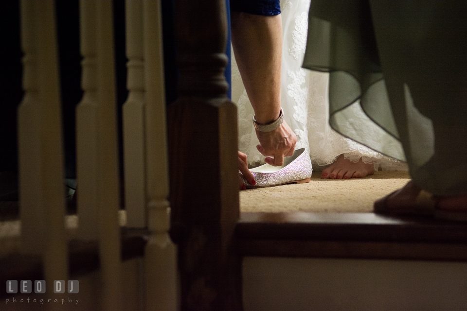 Mother of Bride put a coin inside Bride's shoes. Historic Inns of Annapolis Maryland, Governor Calvert House wedding, by wedding photographers of Leo Dj Photography. http://leodjphoto.com