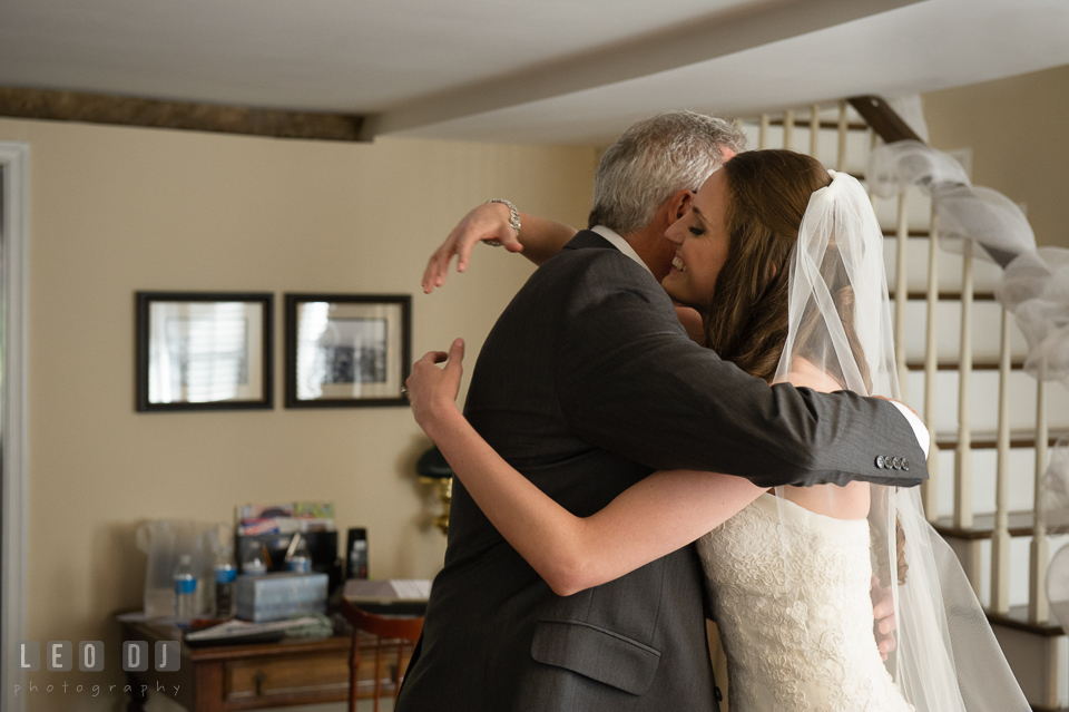 Father of the Bride and daughter hugging after seeing daughter in her wedding dress. Historic Inns of Annapolis Maryland, Governor Calvert House wedding, by wedding photographers of Leo Dj Photography. http://leodjphoto.com