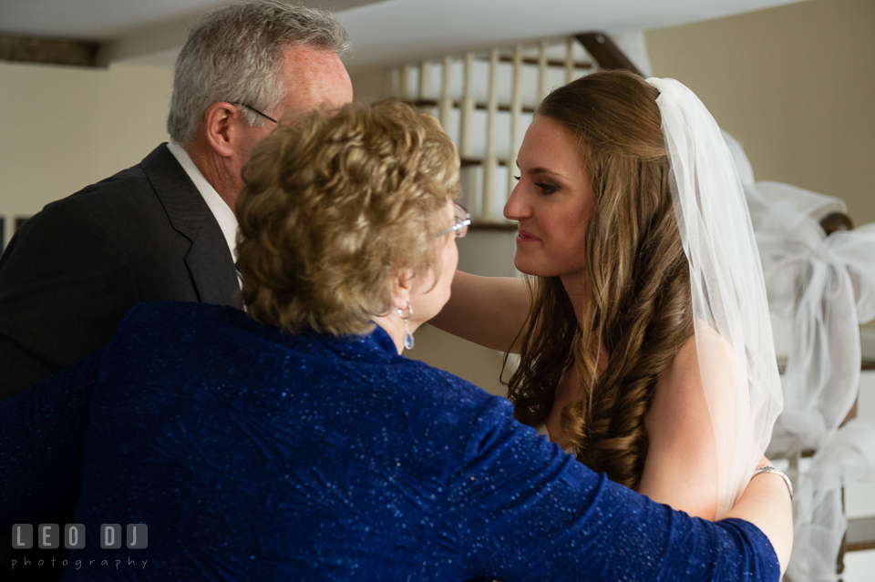Mother of the Bride hugging her husband and daughter. Historic Inns of Annapolis Maryland, Governor Calvert House wedding, by wedding photographers of Leo Dj Photography. http://leodjphoto.com