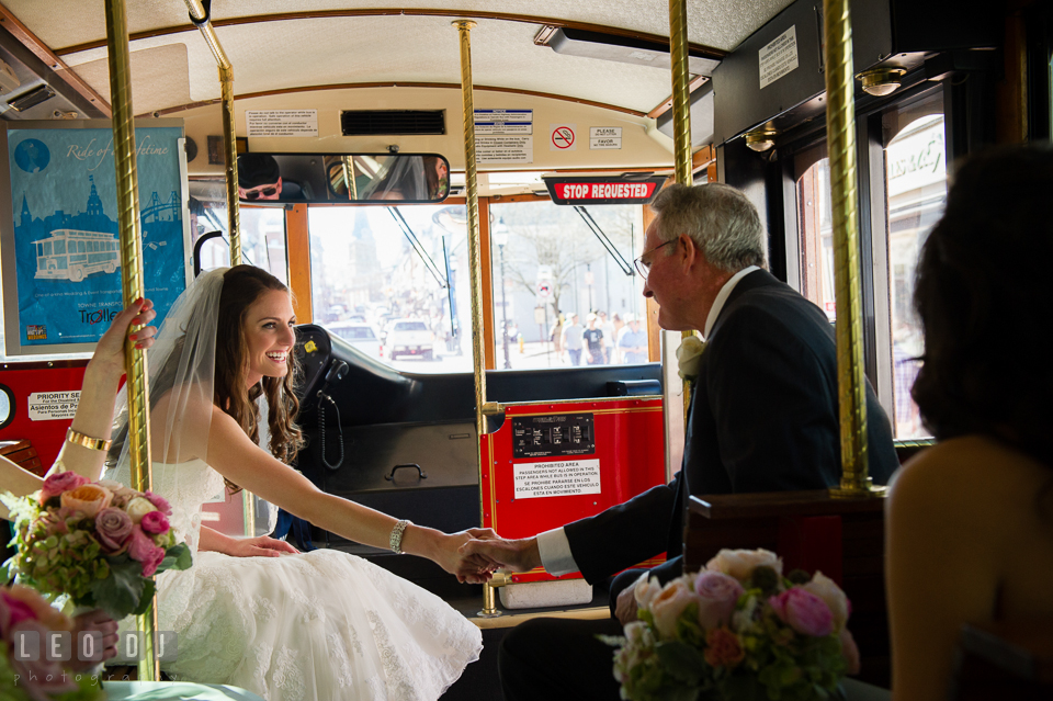 Bride holding her Father's hand in the trolley on their way to the ceremony at the church. Historic Inns of Annapolis Maryland, Governor Calvert House wedding, by wedding photographers of Leo Dj Photography. http://leodjphoto.com