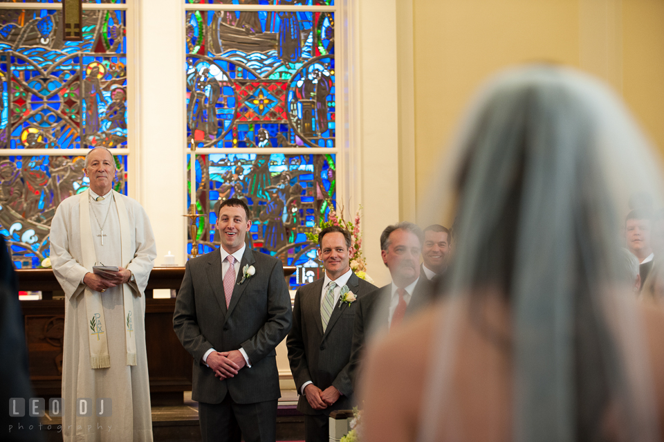 Groom emotional seeing Bride for the first time at Calvary United Methodist Church. Historic Inns of Annapolis Maryland, Governor Calvert House wedding, by wedding photographers of Leo Dj Photography. http://leodjphoto.com