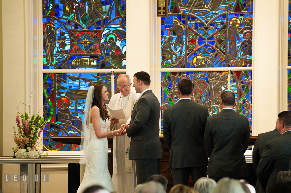 Bride and Groom smiling during their wedding vows at Calvary United Methodist Church. Historic Inns of Annapolis Maryland, Governor Calvert House wedding, by wedding photographers of Leo Dj Photography. http://leodjphoto.com