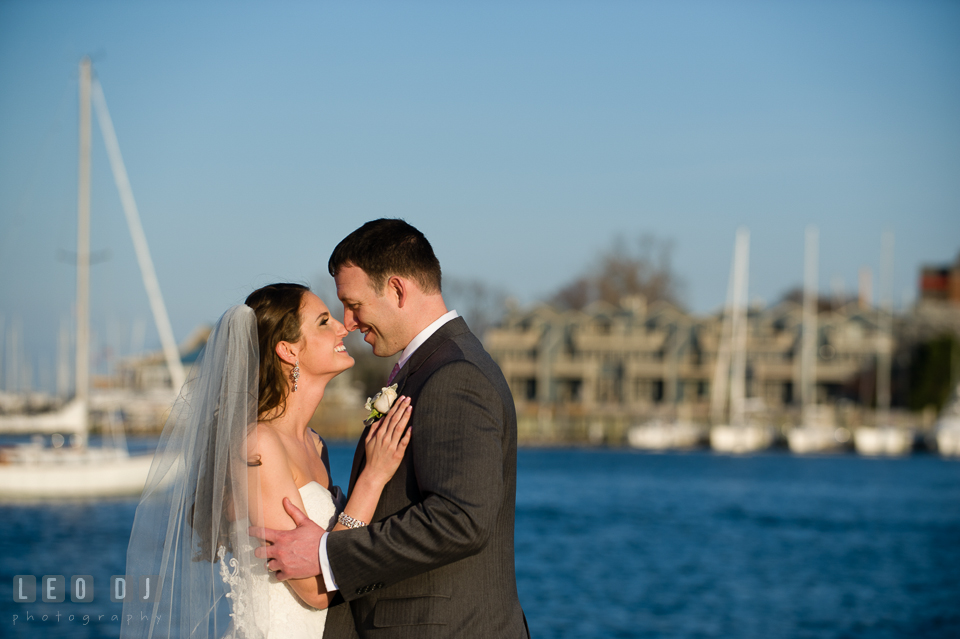 Bride and Groom getting close and hugging at the Annapolis downtown harbor. Historic Inns of Annapolis Maryland, Governor Calvert House wedding, by wedding photographers of Leo Dj Photography. http://leodjphoto.com