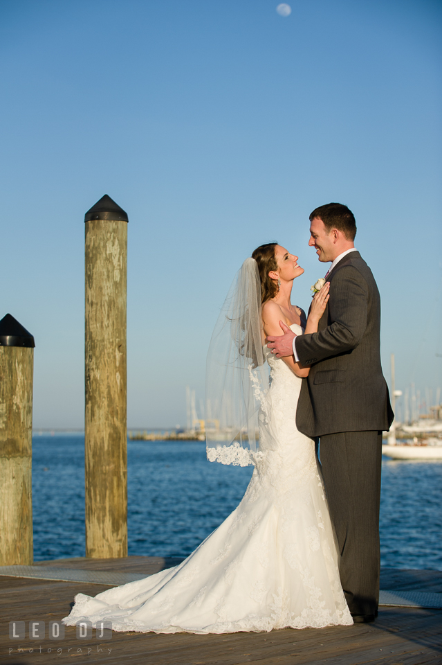 Bride and Groom holding close by the water at the Annapolis dock. Historic Inns of Annapolis Maryland, Governor Calvert House wedding, by wedding photographers of Leo Dj Photography. http://leodjphoto.com