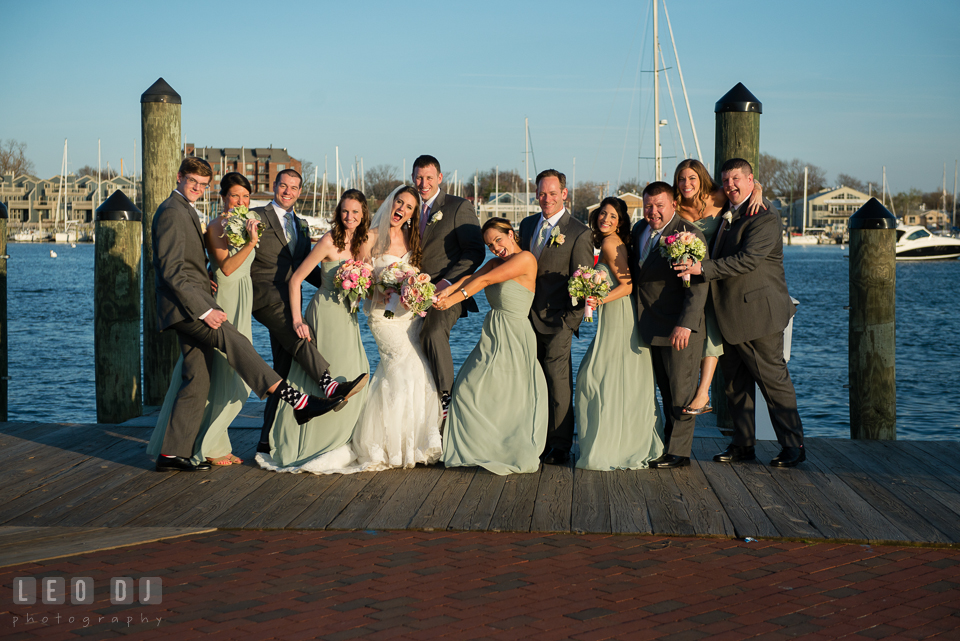 Bride and Groom with their Wedding Party doing fun and goofy post at the Annapolis dock. Historic Inns of Annapolis Maryland, Governor Calvert House wedding, by wedding photographers of Leo Dj Photography. http://leodjphoto.com