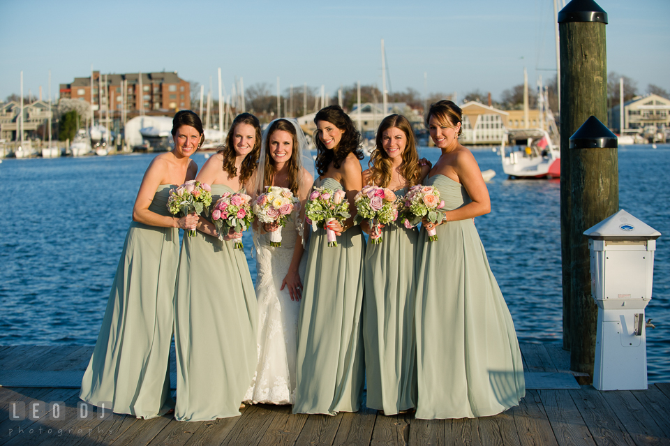 Bride, Maid of Honor and Bridesmaids posing on the Annapolis downtown dock. Historic Inns of Annapolis Maryland, Governor Calvert House wedding, by wedding photographers of Leo Dj Photography. http://leodjphoto.com