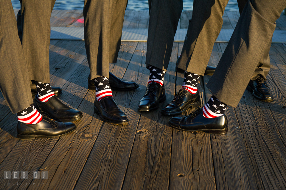 Groom and his groom's party wearing American flag pattern socks. Historic Inns of Annapolis Maryland, Governor Calvert House wedding, by wedding photographers of Leo Dj Photography. http://leodjphoto.com