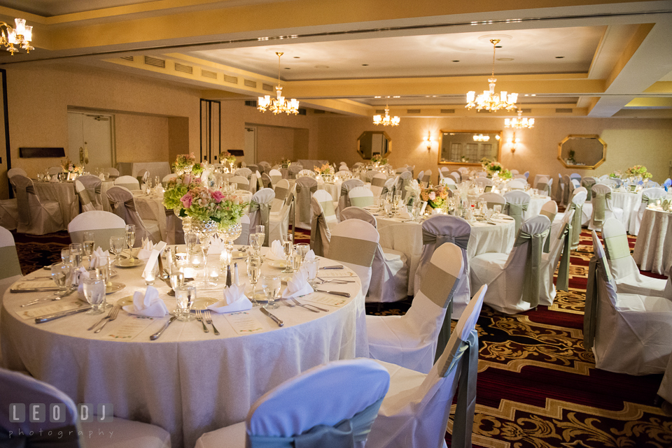 View of Governor's Hall with the guests dining tables and the centerpieces. Historic Inns of Annapolis Maryland, Governor Calvert House wedding, by wedding photographers of Leo Dj Photography. http://leodjphoto.com