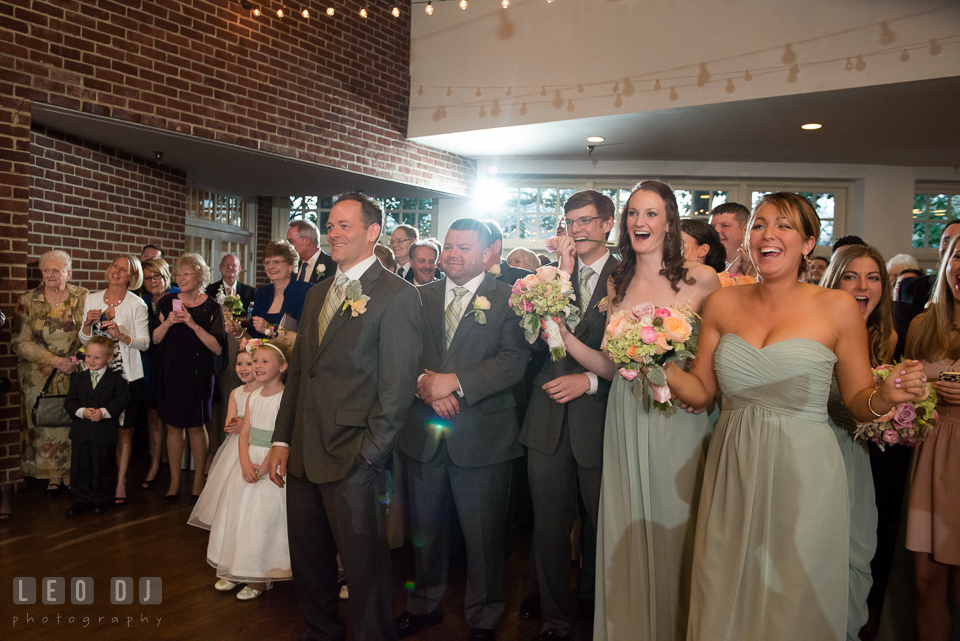 Bridal and Groom's party and all guests laughing and cheering Bride and Groom during the introduction. Historic Inns of Annapolis Maryland, Governor Calvert House wedding, by wedding photographers of Leo Dj Photography. http://leodjphoto.com