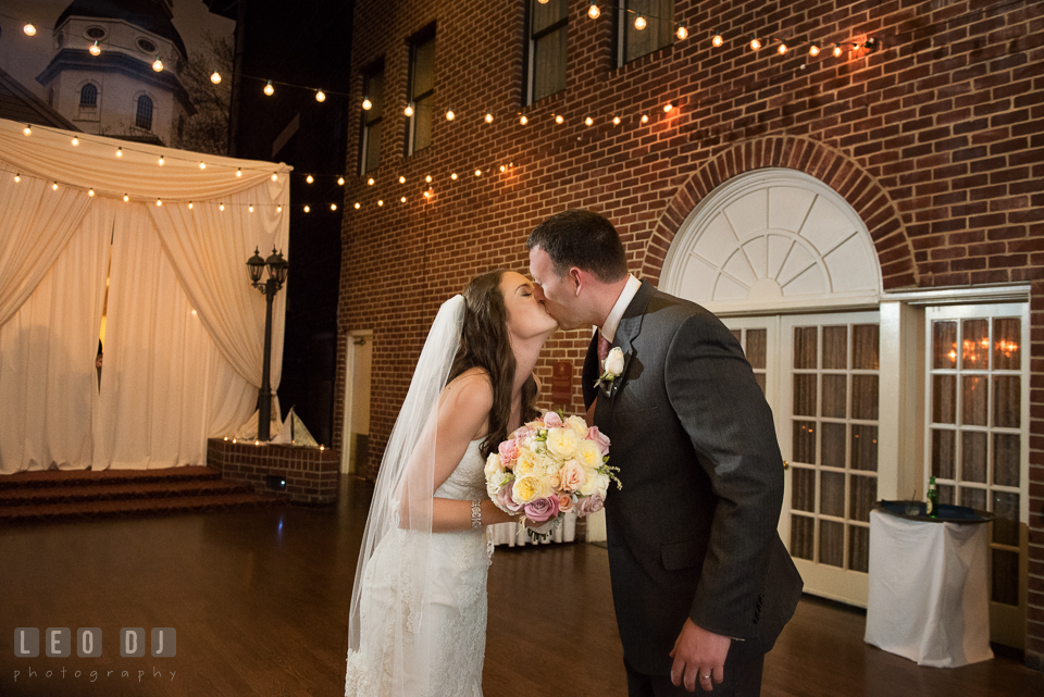 Bride and Groom kissed right after the introduction by the DJ from Beat2Beat DJ's. Historic Inns of Annapolis Maryland, Governor Calvert House wedding, by wedding photographers of Leo Dj Photography. http://leodjphoto.com