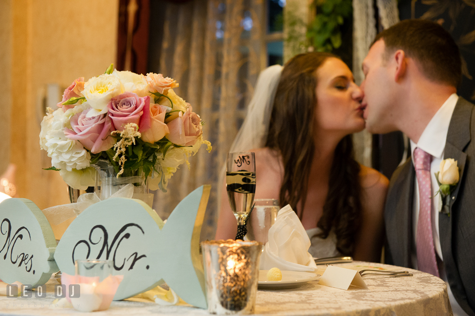 Bride and Groom kissing by the sweetheart table. Historic Inns of Annapolis Maryland, Governor Calvert House wedding, by wedding photographers of Leo Dj Photography. http://leodjphoto.com