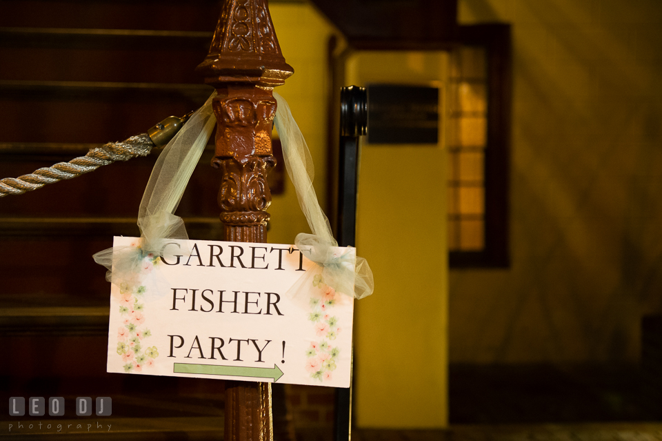 Sign of the Bride and Groom's last name and direction hung at the front of the venue. Historic Inns of Annapolis Maryland, Governor Calvert House wedding, by wedding photographers of Leo Dj Photography. http://leodjphoto.com