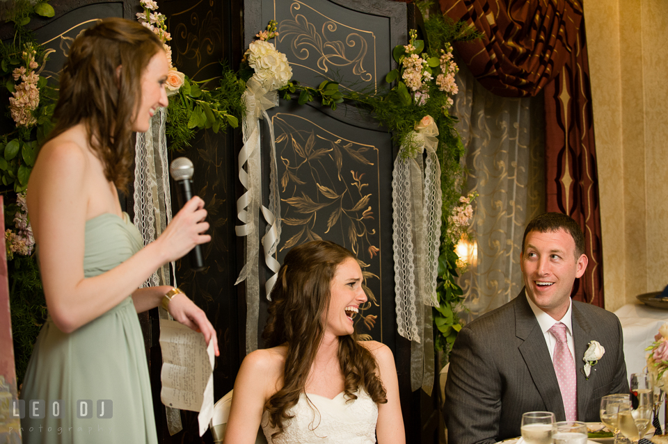 Bride and Groom laughing listening to Maid of Honor's toast speech. Historic Inns of Annapolis Maryland, Governor Calvert House wedding, by wedding photographers of Leo Dj Photography. http://leodjphoto.com