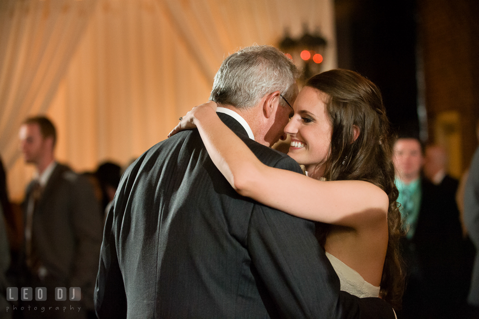 Bride smiling while dancing with Father during parent dance. Historic Inns of Annapolis Maryland, Governor Calvert House wedding, by wedding photographers of Leo Dj Photography. http://leodjphoto.com