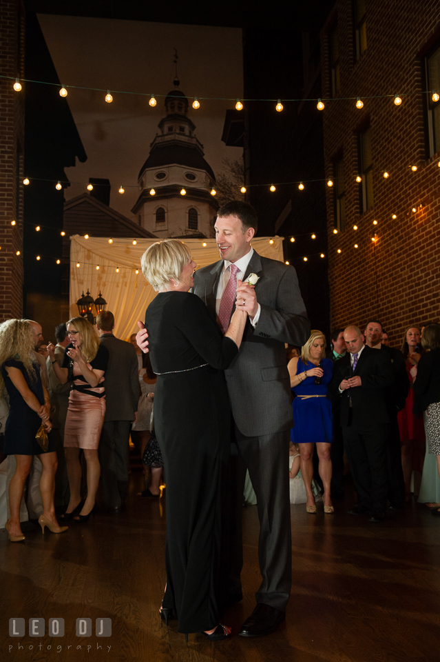 Groom smiling during the Mother and son dance. Historic Inns of Annapolis Maryland, Governor Calvert House wedding, by wedding photographers of Leo Dj Photography. http://leodjphoto.com