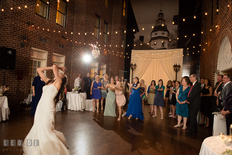 Bride tossed her bouquet toward the single ladies crowd. Historic Inns of Annapolis Maryland, Governor Calvert House wedding, by wedding photographers of Leo Dj Photography. http://leodjphoto.com