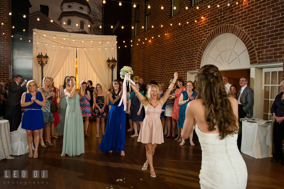 One of the guest happily cheered after she caught the flower bouquet from the toss. Historic Inns of Annapolis Maryland, Governor Calvert House wedding, by wedding photographers of Leo Dj Photography. http://leodjphoto.com