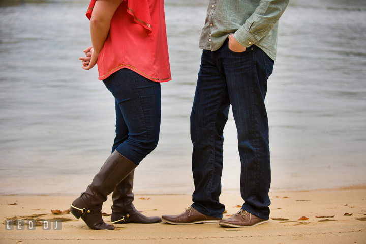Shoes and legs of the engaged couple standing on the beach. Chestertown Eastern Shore Maryland pre-wedding engagement photo session by the water, by wedding photographers of Leo Dj Photography. http://leodjphoto.com