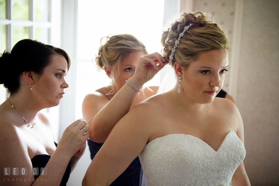 Matron of honor put veil on bride's hair. Kent Manor Inn, Kent Island, Eastern Shore Maryland, wedding ceremony and getting ready photos, by wedding photographers of Leo Dj Photography. http://leodjphoto.com