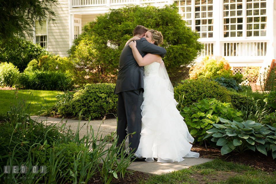 Bride and Groom hugging each other during first look. Kent Manor Inn, Kent Island, Eastern Shore Maryland, wedding ceremony and getting ready photos, by wedding photographers of Leo Dj Photography. http://leodjphoto.com