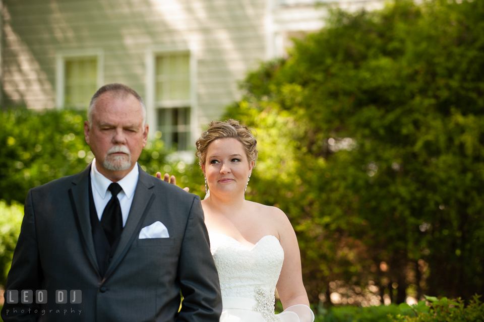 Bride smiled and tap Father's shoulder during first look. Kent Manor Inn, Kent Island, Eastern Shore Maryland, wedding ceremony and getting ready photos, by wedding photographers of Leo Dj Photography. http://leodjphoto.com
