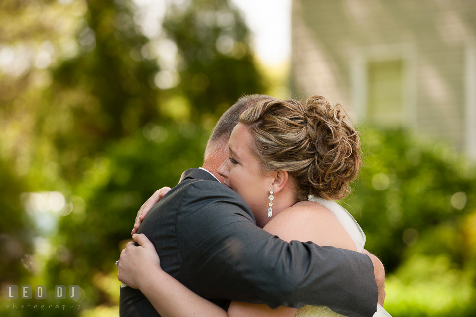 Bride hugging Father during first glance. Kent Manor Inn, Kent Island, Eastern Shore Maryland, wedding ceremony and getting ready photos, by wedding photographers of Leo Dj Photography. http://leodjphoto.com