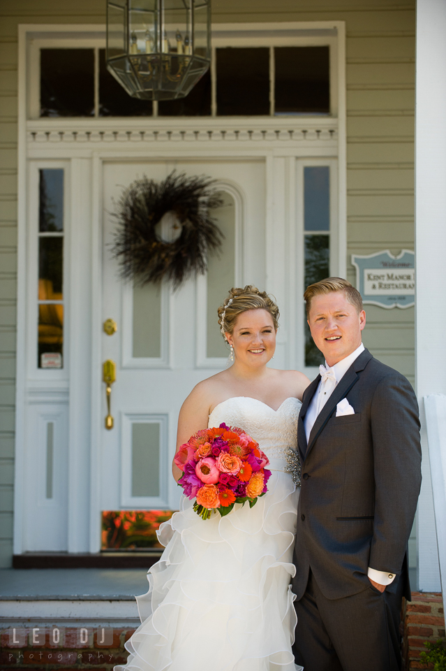 Bride and Groom posing in front of the restaurant entrance. Kent Manor Inn, Kent Island, Eastern Shore Maryland, wedding ceremony and getting ready photos, by wedding photographers of Leo Dj Photography. http://leodjphoto.com