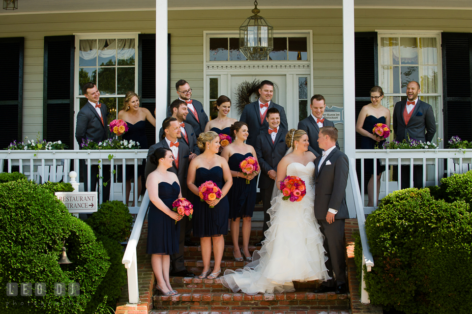 Bride and Groom posing with all the bridesmaids and groomsmen in front of the restaurant. Kent Manor Inn, Kent Island, Eastern Shore Maryland, wedding ceremony and getting ready photos, by wedding photographers of Leo Dj Photography. http://leodjphoto.com