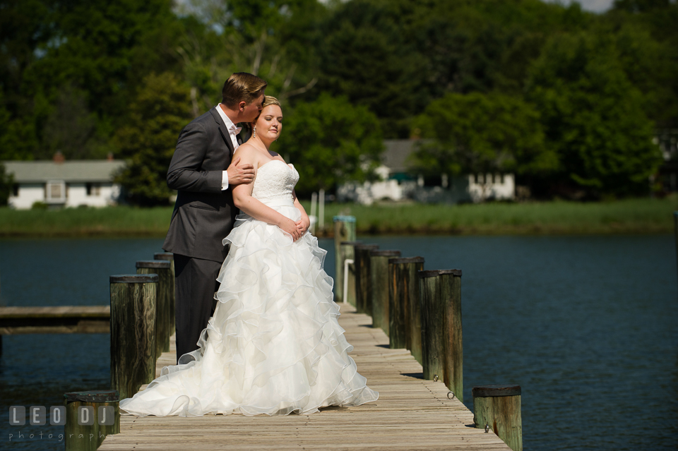 Groom on the dock kissing Bride's temple. Kent Manor Inn, Kent Island, Eastern Shore Maryland, wedding ceremony and getting ready photos, by wedding photographers of Leo Dj Photography. http://leodjphoto.com
