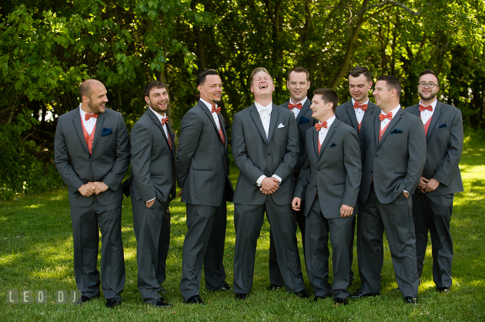 Groom laughing hard watched by the groom's party. Kent Manor Inn, Kent Island, Eastern Shore Maryland, wedding ceremony and getting ready photos, by wedding photographers of Leo Dj Photography. http://leodjphoto.com